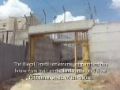 Palestinian home imprisoned by 24 foot cage and surrounded by settlements - English