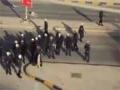 امراة تواجه قوات الشغب في البحرين  - Arabic