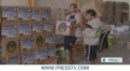 [08/07/13] Iran charitable foundation distributes aid among Gazans - English
