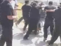 Zionist Security Guards use electric stun guns on the Jewish demonstrators - Hebrew