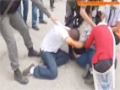 israeli soldiers beating a Palestinian girl and remove her Hijab - English